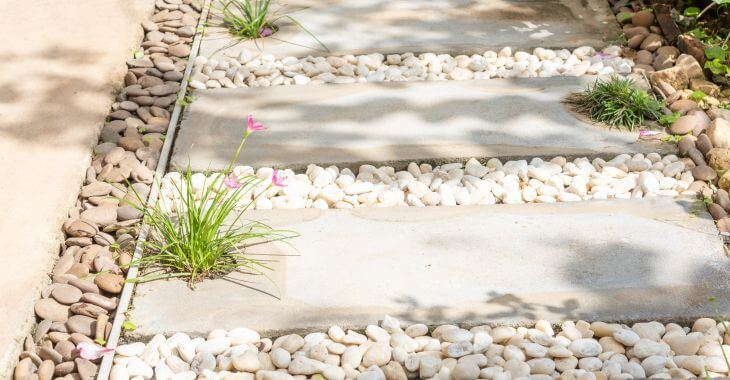 Path made of white and natural color river stones.