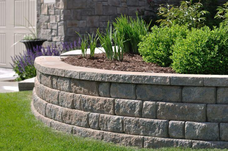 A retaining wall made from natural stone.